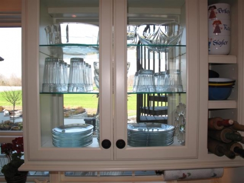 Cabinet Made to Fit around Window with Glass Shelves