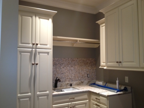 Laundry Room With Shelf And Hanging Rod
